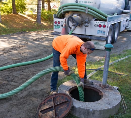 Technician pumping septic