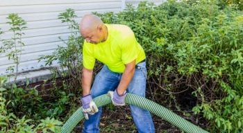Wind River employee pumping septic system