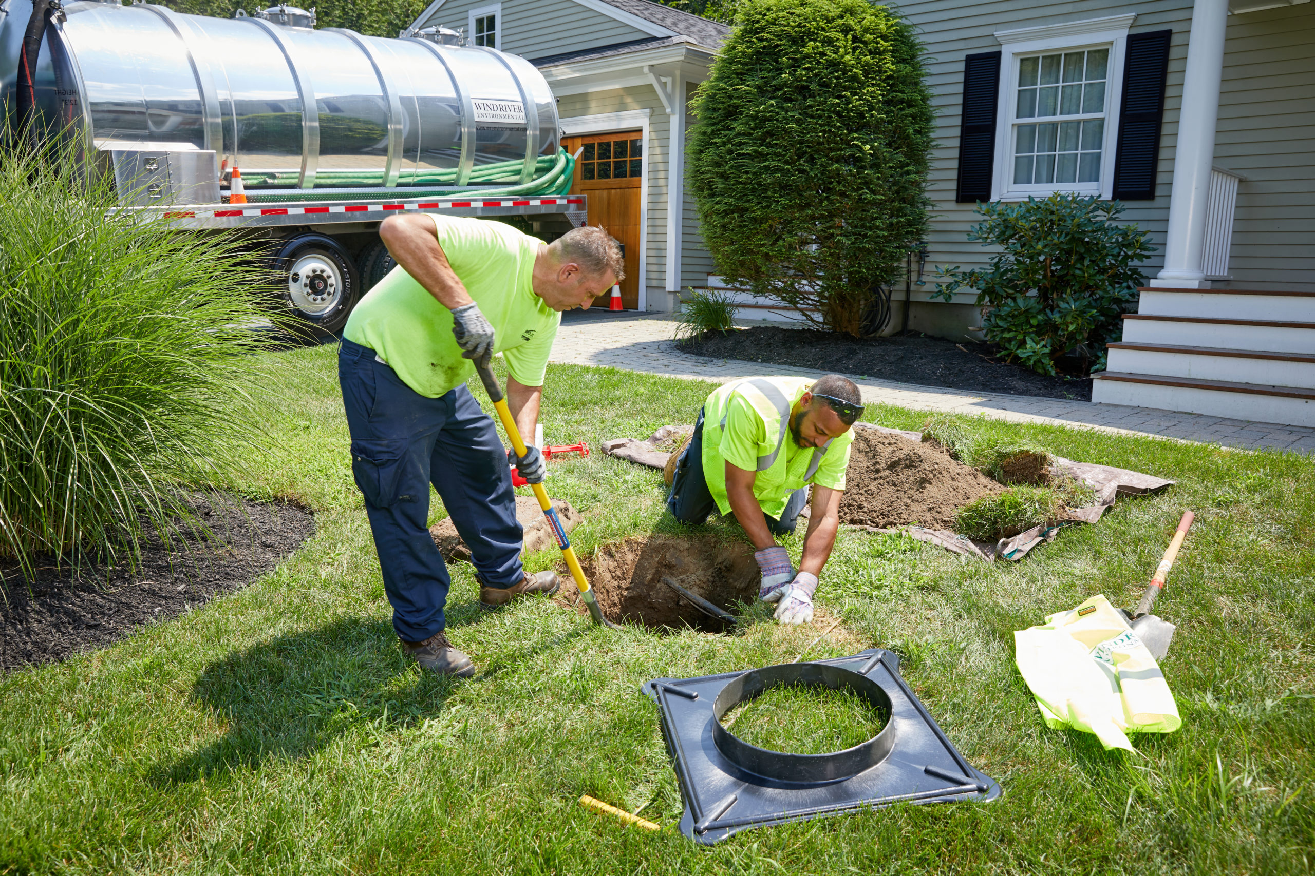 Wind River Techs Doing Septic Tank Maintenance